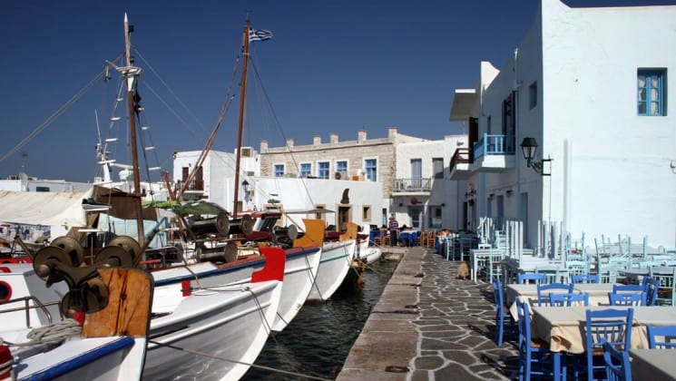 boats are docked at a port in paros, a greek island in the aegean sea