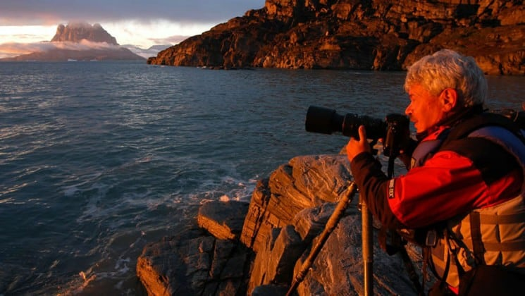 a photographer gets the shot of sunset in greenland