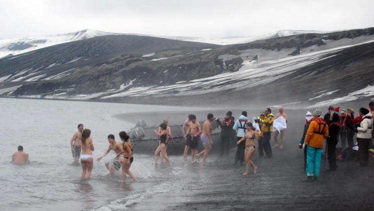 Passengers from the Polar Circle Air Cruise take a plunge into Antarctica's frigid waters