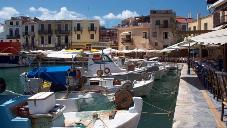 Boats are docked in the harbor in rethymno, a coastal town in crete, greece