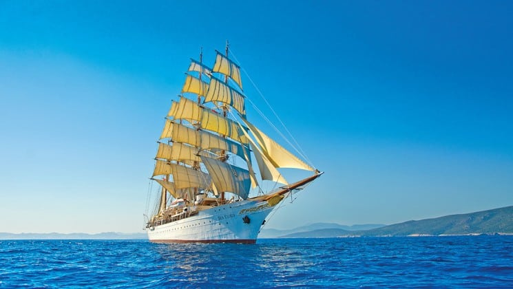 the small ship sea cloud sails across the caribbean on a blue sky day