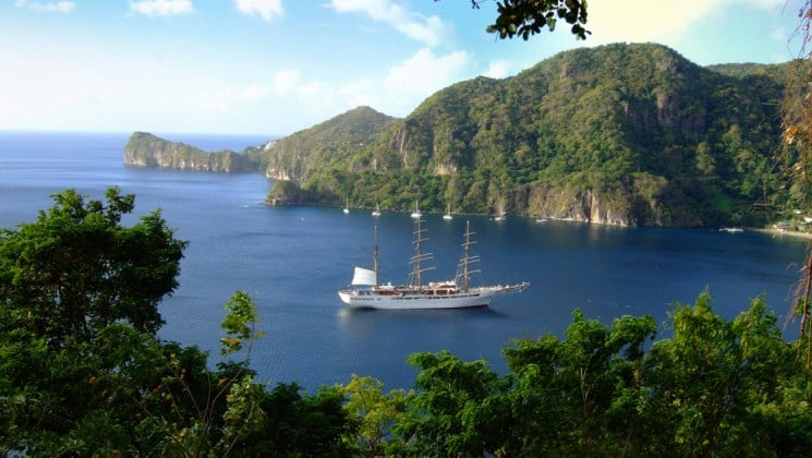 the small ship sea cloud is anchored in a bay at the tropical island st lucia in the caribbean