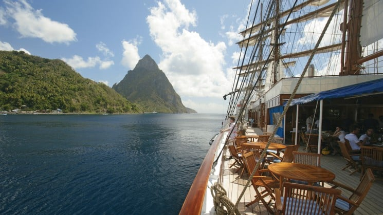 looking off the deck of the small ship sea cloud toward tropical island st lucia in the caribbean