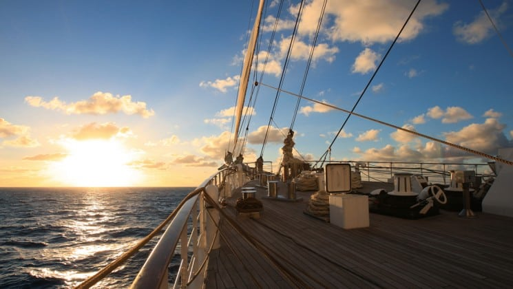 sailing the caribbean on the small ship sea cloud at sunset