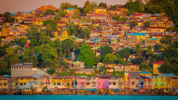 A town with colorful buildings on a hillside and big trees in Ambon Island, Indonesia