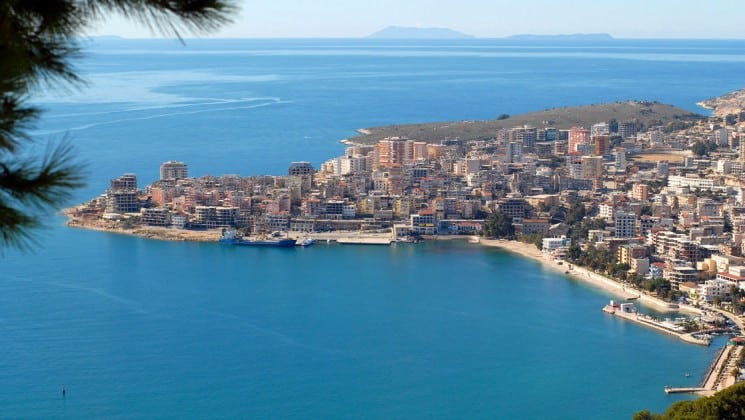 A view of the coastline in saranda in albania with tropical waters and mediterranean architecture