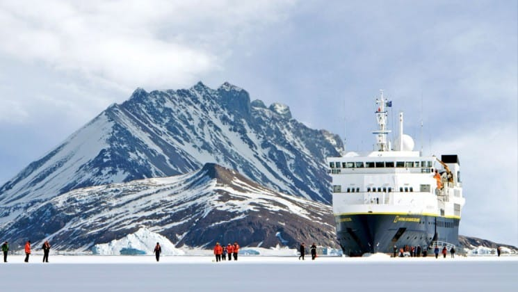 The National Geographic Explorer ship navigates the ocean and icebergs in antarctica