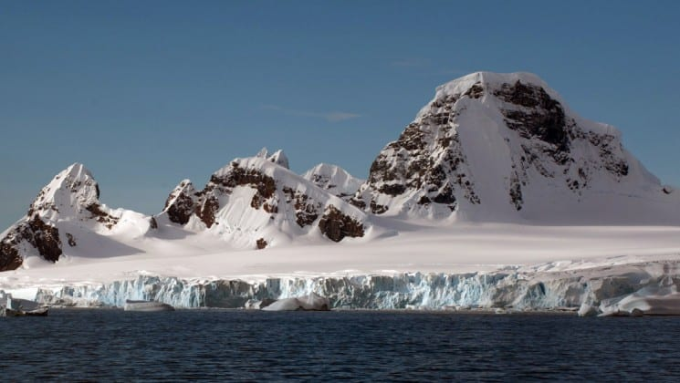 Icebergs and snow-capped mountains, as seen on an expedition to the falklands, south georgia and antarctica
