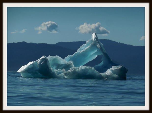 Large floating blue iceberg in Alaska.