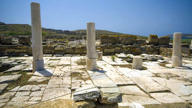 greek ruins in an archaeological site on the island of delos