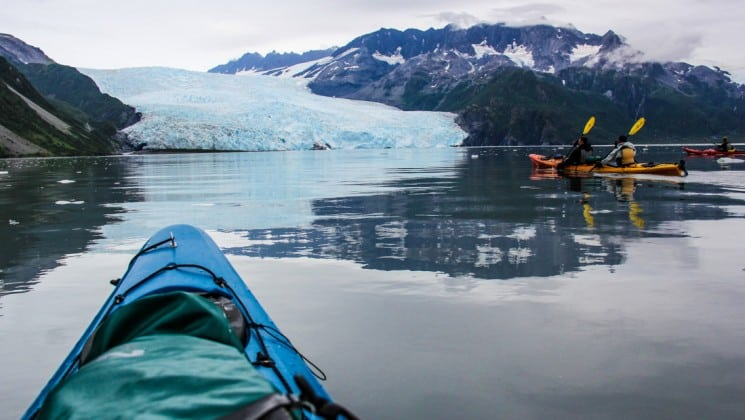 View from a kayak as they are paddling towards a glacier in kenai fjords national park alaska