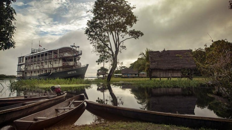 Small ship amatista docks in a remote village in the Peruvian Amazon