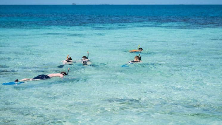 Turquoise water with people snorkeling in Belize