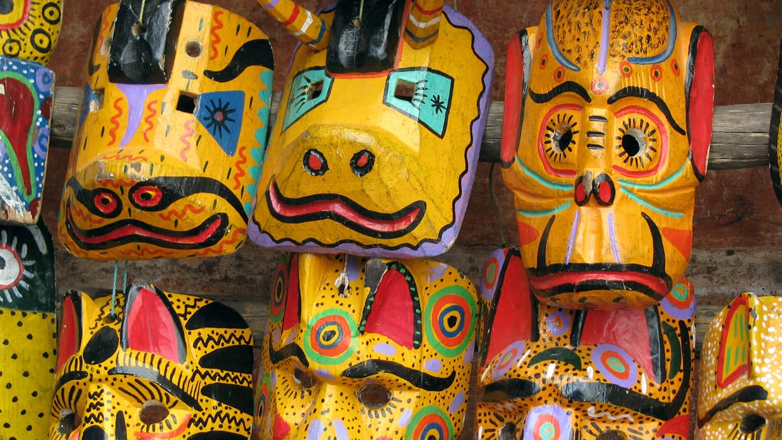 Yellow and other colorful masks made out of wood in Guatemala.