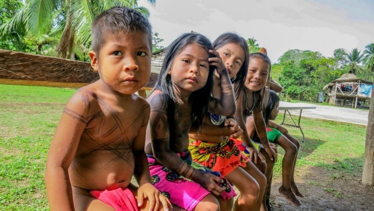 Embera children with colorful clothing and tattooed bodies on Panama cruise