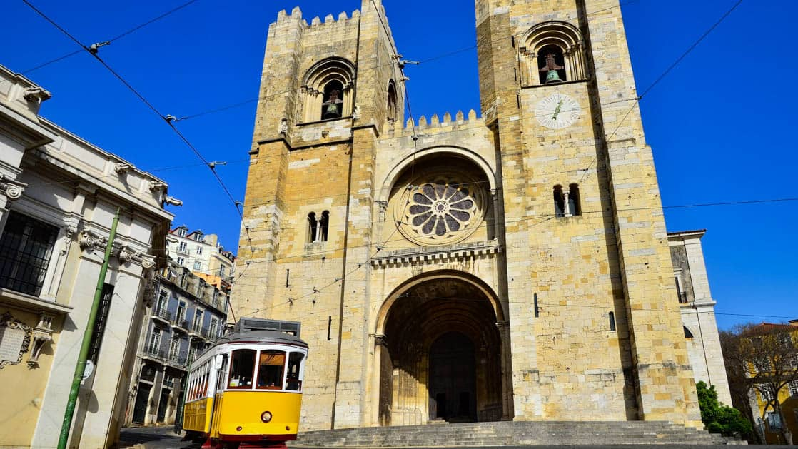 se cathedral theoldest church, and yellow tram americanos , two symbols of lisbon, portugal