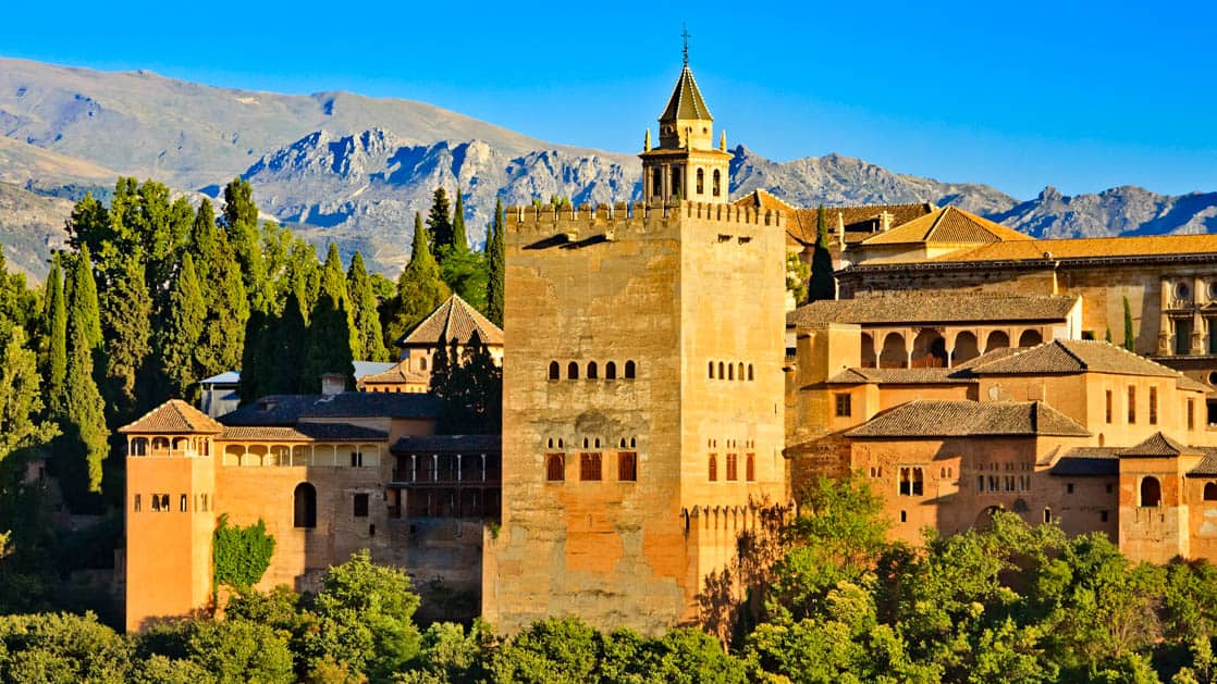 the alhambra in granada spain with the sierra nevada mountains behind