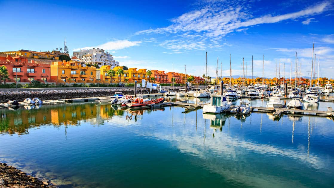 marina de portimao on algarve in southern portugal with colorful buildings and many boats