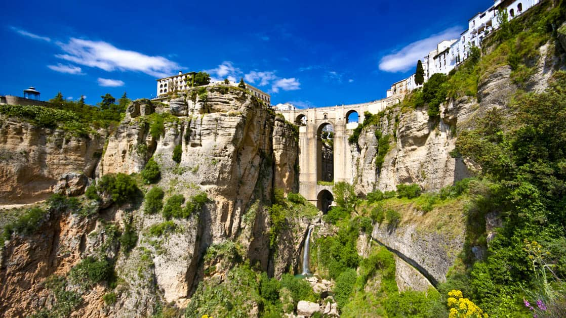 village of rondo in spain built on top the rocky mountain with a bridge