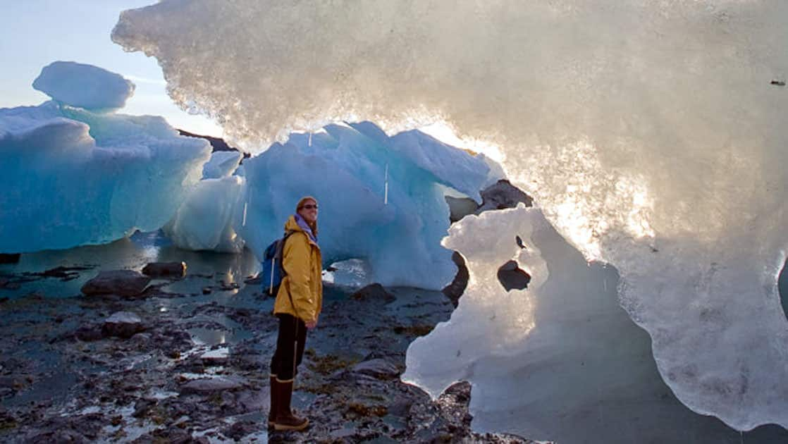 A female walking among the beached icebergs near the Columbia glacier in Prince William Sound Alaska