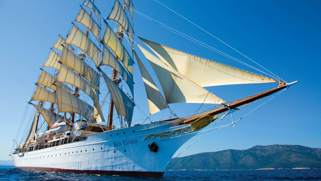 The Sea Cloud under full sail seen from in front of the bow