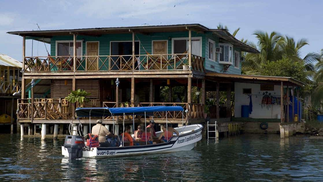 Bocas del Toro lodge right on the water with boats pulling up to the deck in Panama
