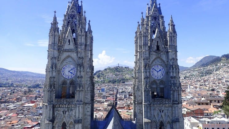 twin clock towers on a sunny day overlooking the city on the quito and guayaquil galapagos land tour