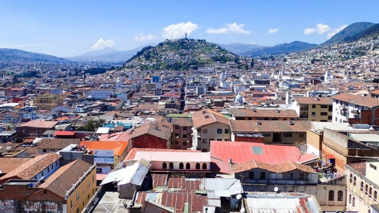 overlooking the city on a sunny day with mountains in the distance on the quito and guayaquil galapagos land tour