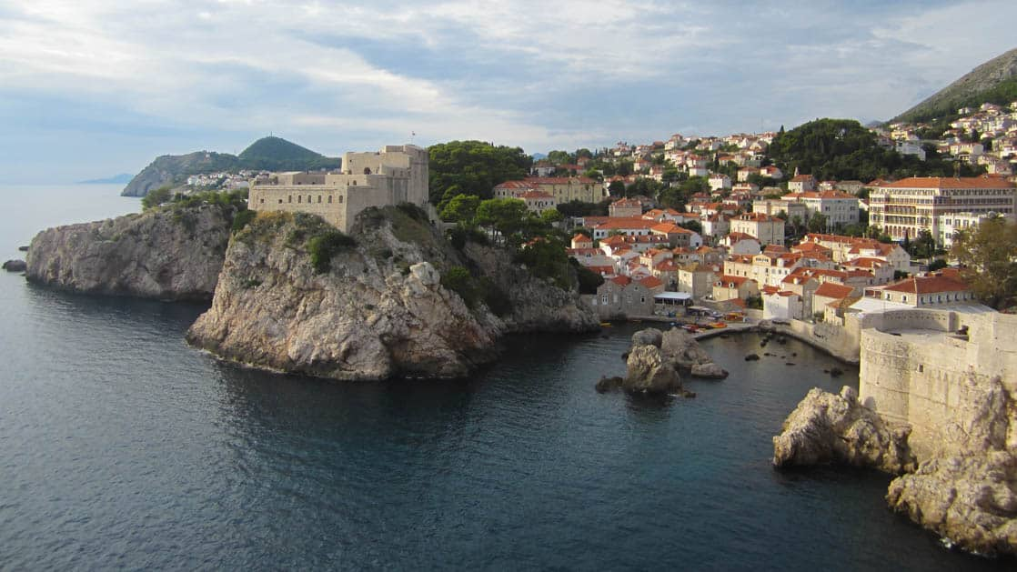 Seaside town in croatia with fortress walls on the cliffs by the water