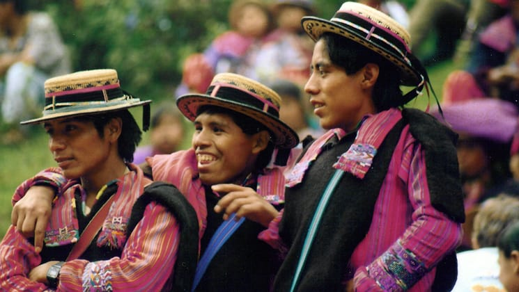 A group of boys in colorful, tradition outfits and hats in Guatemala.