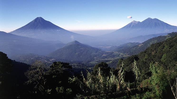 Three volcanos seen from a mountain in Guatemala.