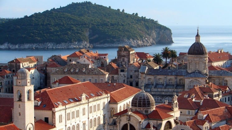 A view of the old city in dubrovnik, croatia, with the mediterranean coast line in the background