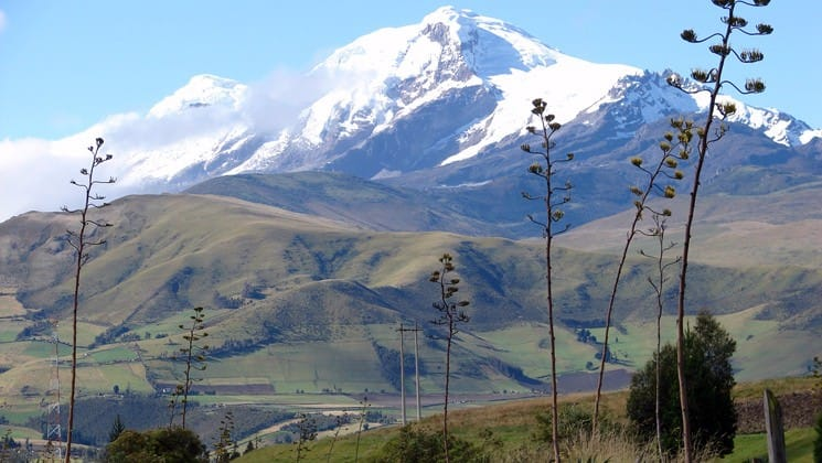snow-covered mountains in distance on andes highland haciendas ecuador land tour