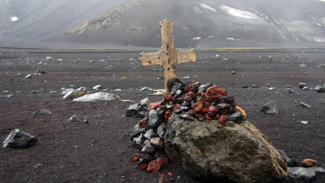 grave site with flowers and a cross on the Antarctic Peninsula Including South Shetland Islands cruise