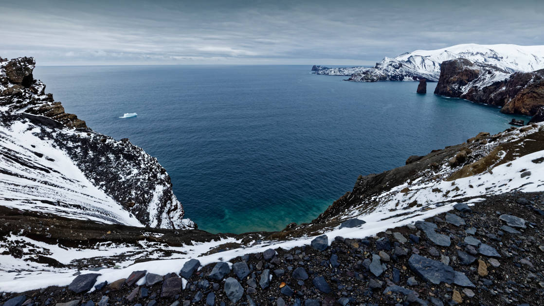 Antarctic Peninsula with beautiful blue bay with turquoise water