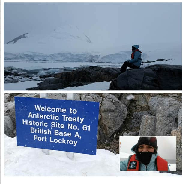 "Guest from a small cruise ship in Antarctica posing by the ""Welcome to Antarctic Treaty Historic Site No. 61 British Base A, Port Lockroy"" sign."