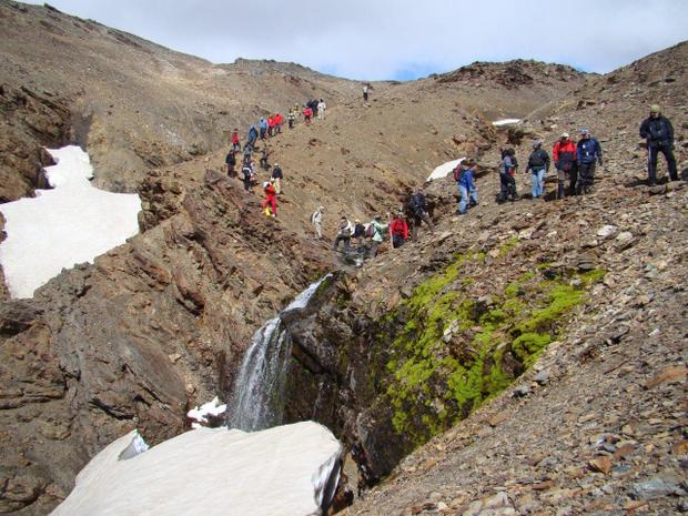 Group hiking on a small ship cruise excursion in Antarctica.
