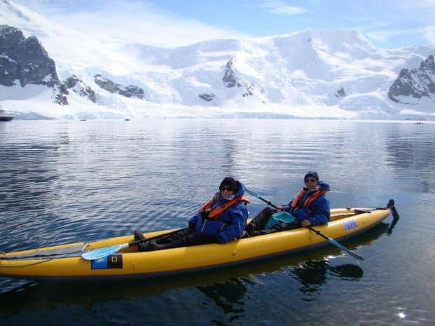Couple kayaking in Antarctica from their small ship cruise.