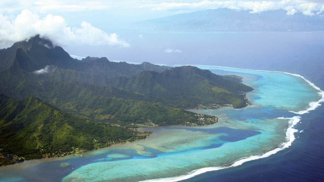 Aerial of Moorea and Tahiti in the South Pacific islands, French Polynesia with clouds above