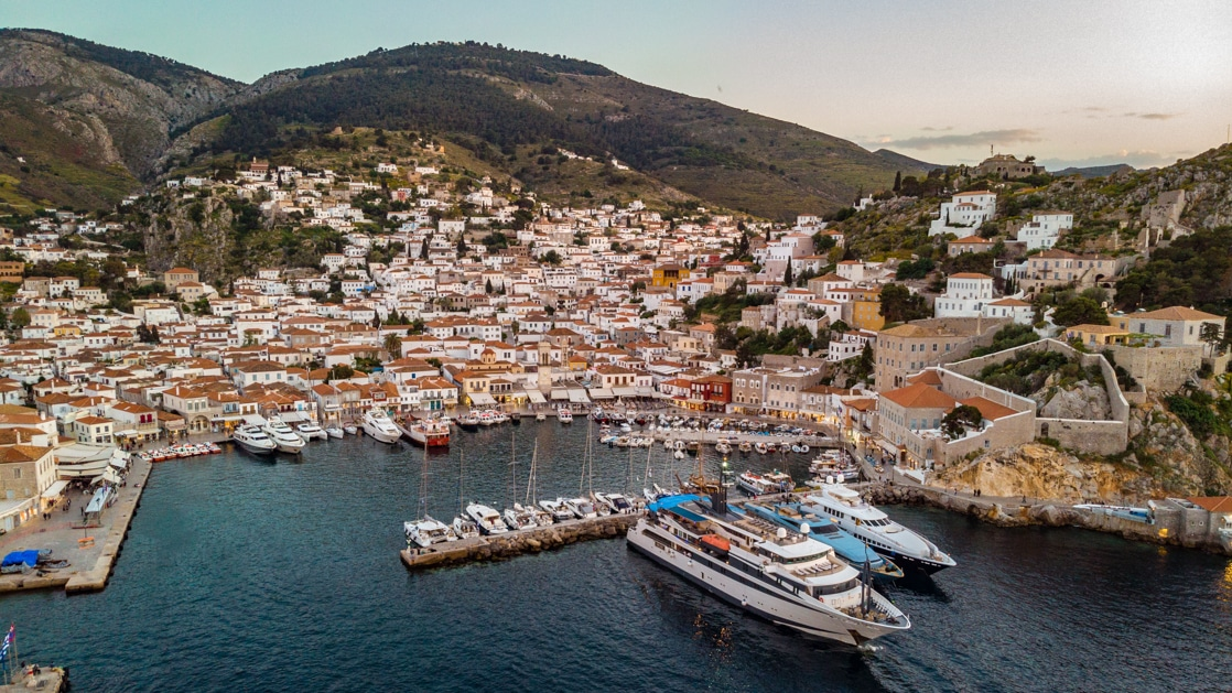 Aerial view of mega yacht Variety Voyager docked in a small harbor during the Best of Greece & Turkey cruise.
