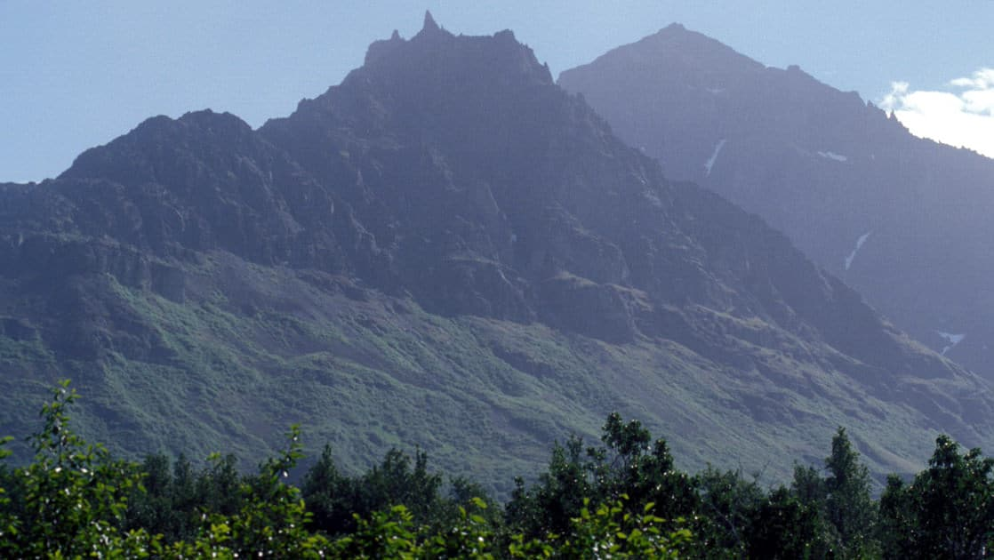 view of the green mountain peaks in katmai national park of alaska