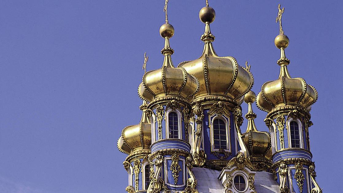 The gold onion domes of Catherine's Palace against the blue sky in Pushkin near St Petersburg, Russia