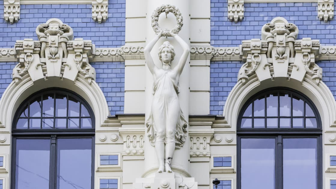 Art Nouveau style architecture locally known as Jugendstil, Riga, Latvia with white statutes and detail on a blue brick buildling