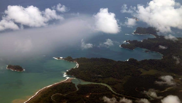 aerial of costa rica coast among clouds