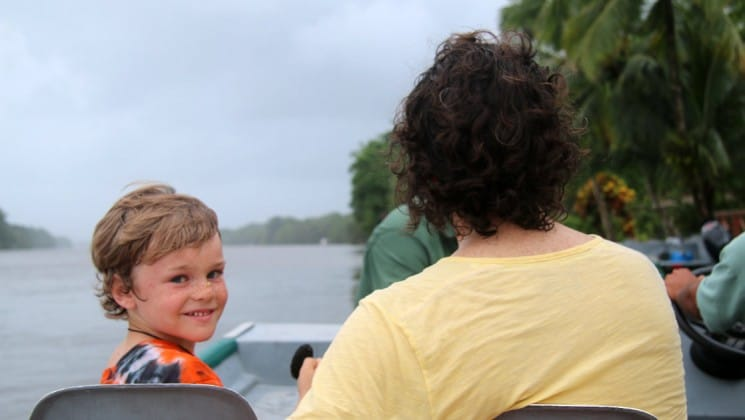 father and son on boat on costa rica family adventure land tour