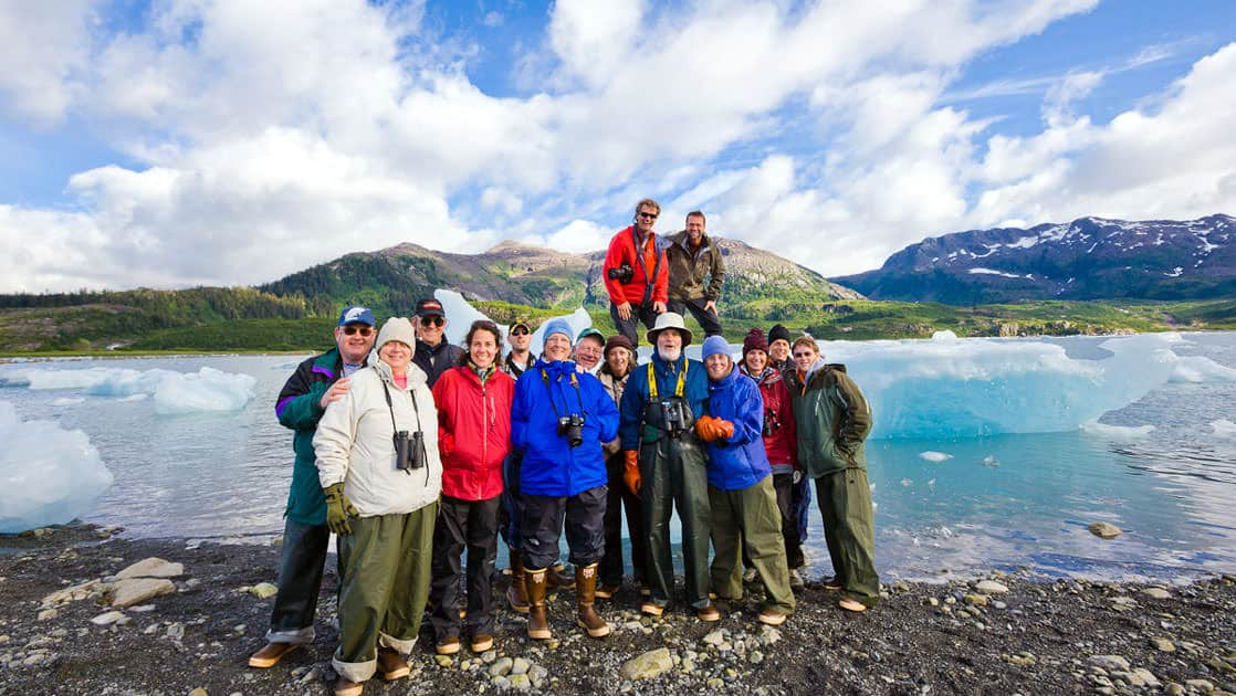 Passengers from the MV Discovery pose in front of the stranded icebergs in Nellie Jauan Lagoon, Prince William Sound, Alaska