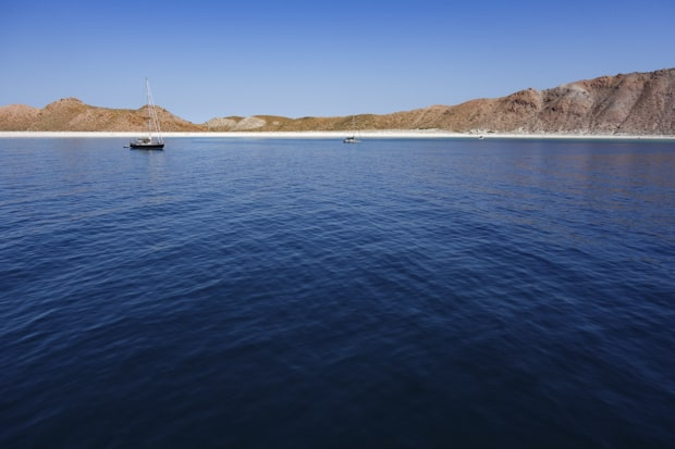 Small ship in calm seas in Baja California.