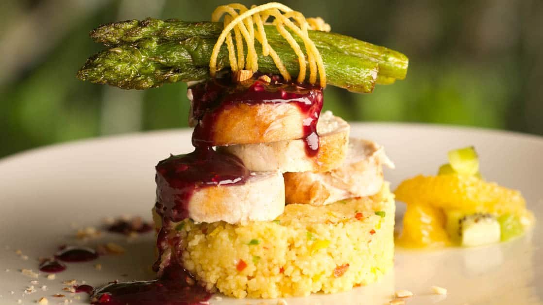 delicious looking colorfully stacked amazonian food on a clean white dish