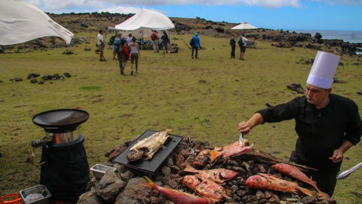 chef grilling fish near ocean on explora rapa nui easter island land tour