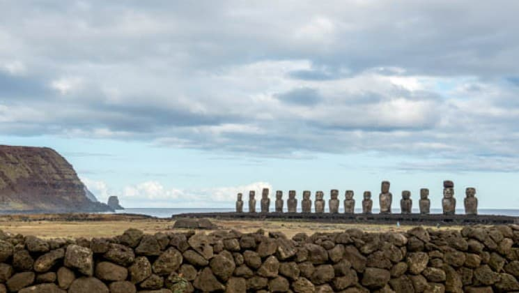 landscape of easter island statues on cloudy day on explora rapa nui land tour in chile
